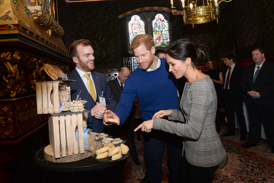 Prince Harry and Meghan Markle enjoy a taste of Wales made in Wrexham - Meghan loves Welsh Cakes and Prince Harry puts Marmite on his crumpets!